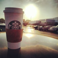Photo taken at Starbucks by Erik C. on 5/22/2012