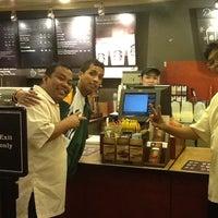 Photo taken at Starbucks Coffee by Eyshiel L. on 2/13/2012