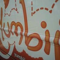 Photo taken at Yumbii by Travis S. on 4/14/2011