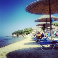 Photo taken at Mango Beach Bar by Michalis C. on 8/23/2012