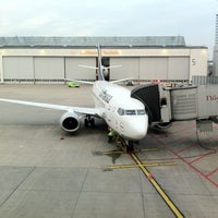 Photo taken at Gate A74 by Giancarlo F. on 3/20/2012