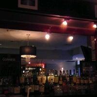 Photo taken at Stella Manhattan Bistro by Atif S. on 4/3/2012