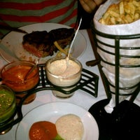 Photo taken at La Boca Steaks by Lilly V. on 3/25/2012