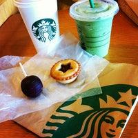 Photo taken at Starbucks by Ayaka I. on 4/8/2012