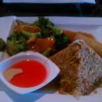 Photo taken at Sweet Ginger Asian Bistro & Sushi by Schona V. on 2/18/2012