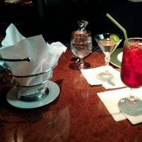 Photo taken at The Loft Restaurant by Tom B. on 3/23/2012