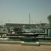 Photo taken at Yas Marina & Yacht Club by Rodrigo D. on 3/14/2012
