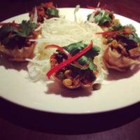 Photo taken at Cozy Thai Bistro by Kathleen W. on 2/16/2012