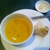 Photo taken at Pi-Tom's Thai Cuisine by Kitchen C. on 7/10/2012