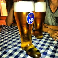 Photo taken at Hofbräu München Beer Hall by Sergio G. on 5/18/2012