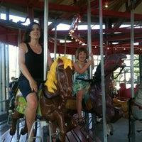 Photo taken at Greenport Antique Carousel by John L. on 7/14/2012