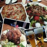 Photo taken at Brotzeit German Bier Bar & Restaurant by WeiQi W. on 7/29/2012