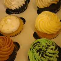 Photo taken at The Sweet Tooth - Cupcakery and Dessert Shop by Shanna B. on 7/14/2012