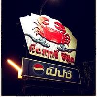 Photo taken at Ruangrit Seafood by GingKo L. on 7/26/2012