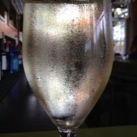 Photo taken at The Grove Wine Bar & Kitchen - West Lake by Daniel K. on 4/3/2012