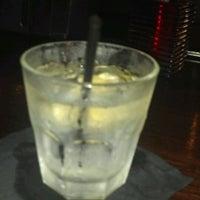 Photo taken at Mom's Bar & Lounge by Thomas C. on 8/2/2012