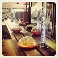 Photo taken at YO! Sushi by Maria R. on 6/22/2012