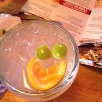Photo taken at Applebee's Neighborhood Grill & Bar by Erin G. on 7/8/2012