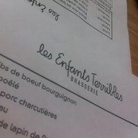 Photo taken at Les Enfants Terribles Brasserie by Corinne L. on 3/14/2012
