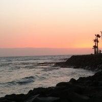 Photo taken at Las Vistas Beach by Nina T. on 7/12/2012