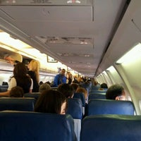 Photo taken at Delta Airlines Flight 12 by Jacob N. on 1/2/2012
