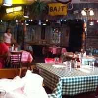 Photo taken at Dixie Kitchen & Bait Shop by PJ M. on 7/8/2012