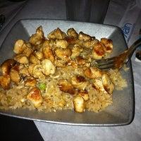Photo taken at Rain Premier Sushi Bar & Bistro by Nicole H. on 8/4/2012