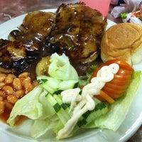 Photo taken at JJ Western Food by Juliana T. on 7/25/2011