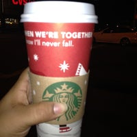 Photo taken at Starbucks by Ivonne T. on 12/12/2011