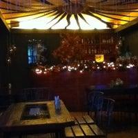 Photo taken at Zaibatsu Cafe Bar by Charmagne M. on 10/28/2011