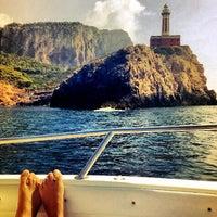Photo taken at Faro di Punta Carena by Ricardo on 8/24/2012
