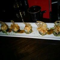 Photo taken at RA Sushi Bar Restaurant by Paul G. on 12/30/2011