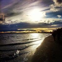 Photo taken at St Kilda Beach by Leonard N. on 7/14/2012
