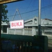 Photo taken at Nasi kuning ambu Ina by Rioe G. on 3/5/2011
