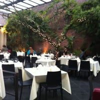 Photo taken at Revel Restaurant and Garden by Laura M. on 5/7/2011