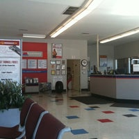 Photo taken at Firestone Complete Auto Care by Kenji Y. on 10/12/2011