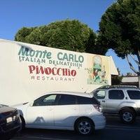 Photo taken at Pinocchio Restaurant & Monte Carlo Italian Deli by Adam K. on 8/29/2011
