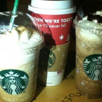 Photo taken at Starbucks Coffee by Dee Vee Ann A. on 12/4/2011