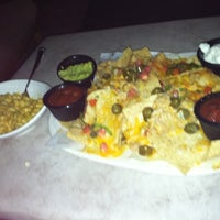 Photo taken at Houlihan's by Lainie K. on 8/25/2011