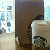 Photo taken at Starbucks by Nathalia F. on 10/10/2011