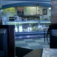 Photo taken at Chompie's Deli by Kelly M. on 8/26/2011