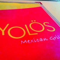 Photo taken at Yolös Mexican Grill by Jeremy W. on 5/22/2012