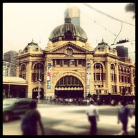 Photo taken at Flinders Street Station by Oliver W. on 4/19/2012