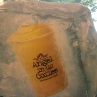 Photo taken at Angel-in-us Coffee by Erisa K. on 8/29/2011