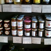 Photo taken at Cork Market & Tasting Room by Anna J. on 7/30/2011