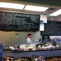Photo taken at Mozzo Deli by Cynthia N. on 11/29/2011