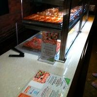 Photo taken at Krunch Pizza Bar by Scott S. on 6/19/2012