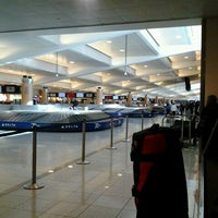 Photo taken at South Baggage Claim by Larry L. on 12/8/2011