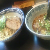 Photo taken at 麺屋 どげんか by Yuichiro N. on 7/21/2012