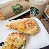 Photo taken at Starbucks by Karina R. on 8/6/2012